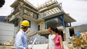 Couple inspecting home construction site
